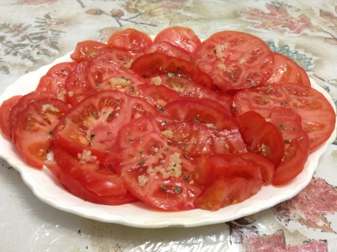 Sliced Ugli ripe Tomatoes with oil, vinegar and garlic