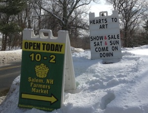 Salem Farmer's Market sign in the snow on Lake Street
